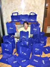 Woman with reusable shopping bags